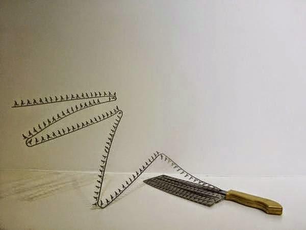 فنان ينحت مجسمات على شفرة السكين bntpal_1437383255_27