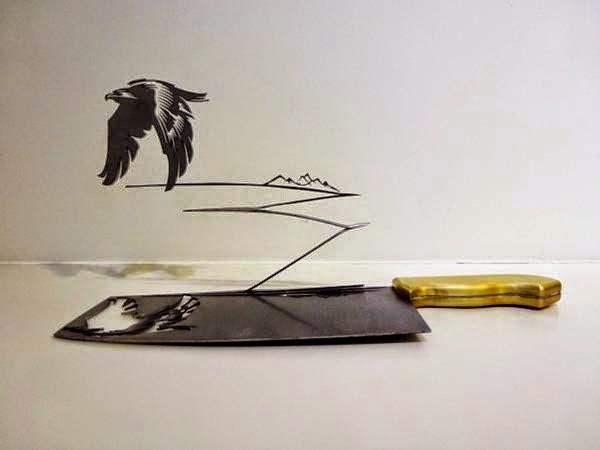 فنان ينحت مجسمات على شفرة السكين bntpal_1437383255_56