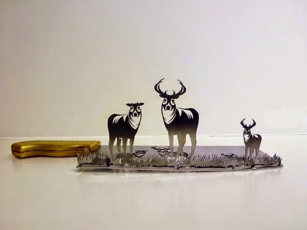 فنان ينحت مجسمات على شفرة السكين bntpal_1437383256_41