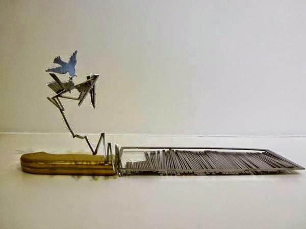 فنان ينحت مجسمات على شفرة السكين bntpal_1437383256_54