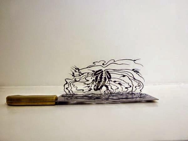 فنان ينحت مجسمات على شفرة السكين bntpal_1437383256_60