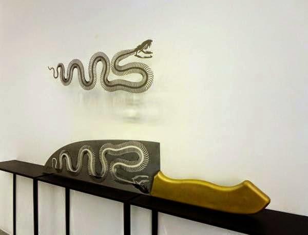 فنان ينحت مجسمات على شفرة السكين bntpal_1437383256_71