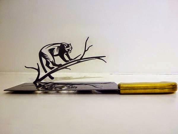 فنان ينحت مجسمات على شفرة السكين bntpal_1437383256_81