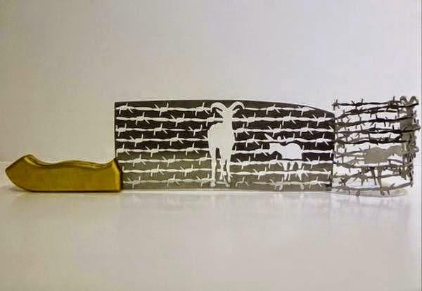 فنان ينحت مجسمات على شفرة السكين bntpal_1437383257_79